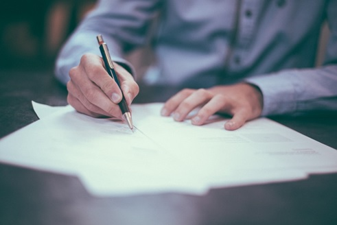 agent sigining a paper