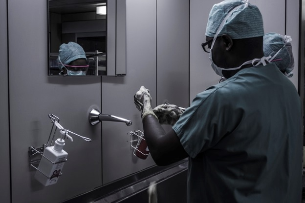 A doctor washing his hands before surgery