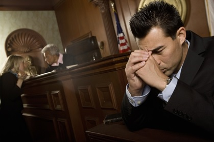 A stressed out man in the courtroom.