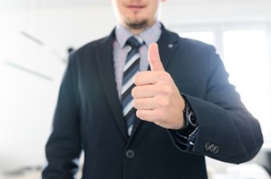 A bail bond agent showing thumbs up