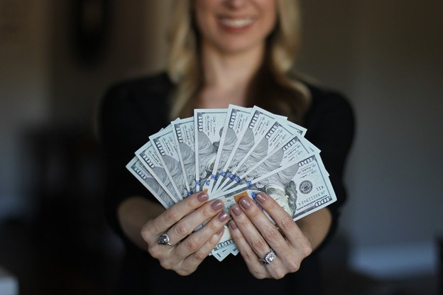 A woman happy after getting the bail money back