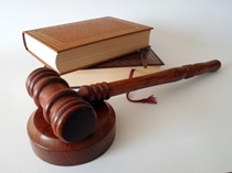 Law books and a wooden gavel