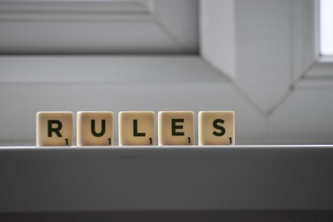 cubes that read RULES on a window sill in building
