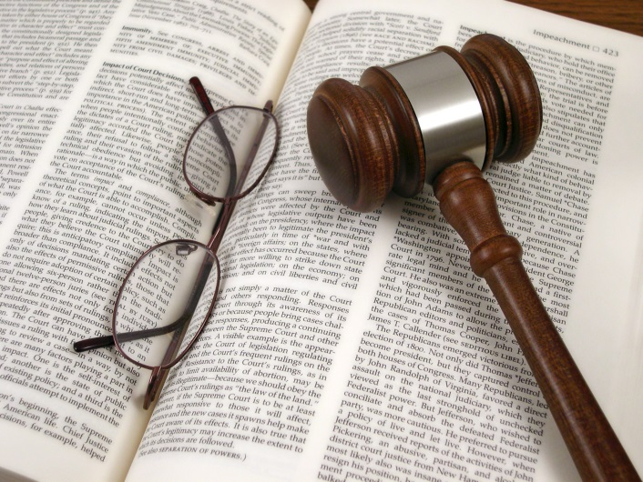 gavel and reading glasses on an open law book